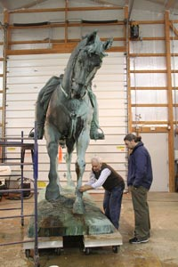 The horse in our shop with senior sculpture conservator Tom Podnar and Dr. Battocchi (blue jacket).