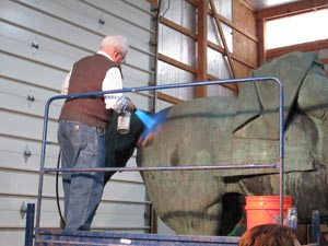 Tom Podnar performing a chemical patination of a lightly cleaned area. Cleaning was performed by high pressure washing.